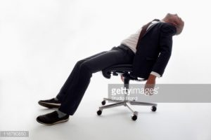 sleeping in a chair an exhausted businessman sleeping in an gettyimages