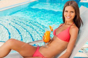 swimming pool chair depositphotos stock photo woman in bikini drinking cocktail
